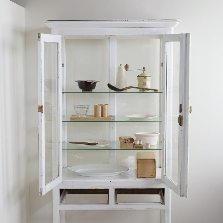 A vintage glass cabinet.