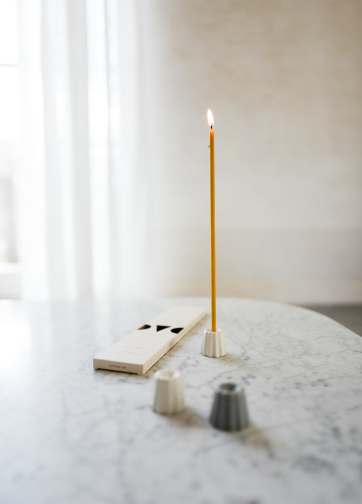 We love the simplicity of the Ovo Things Porcelain Canele Candle Holder (€), just the right size for a set of Ovo Things Five Birthday Candles (€7.50), &#8