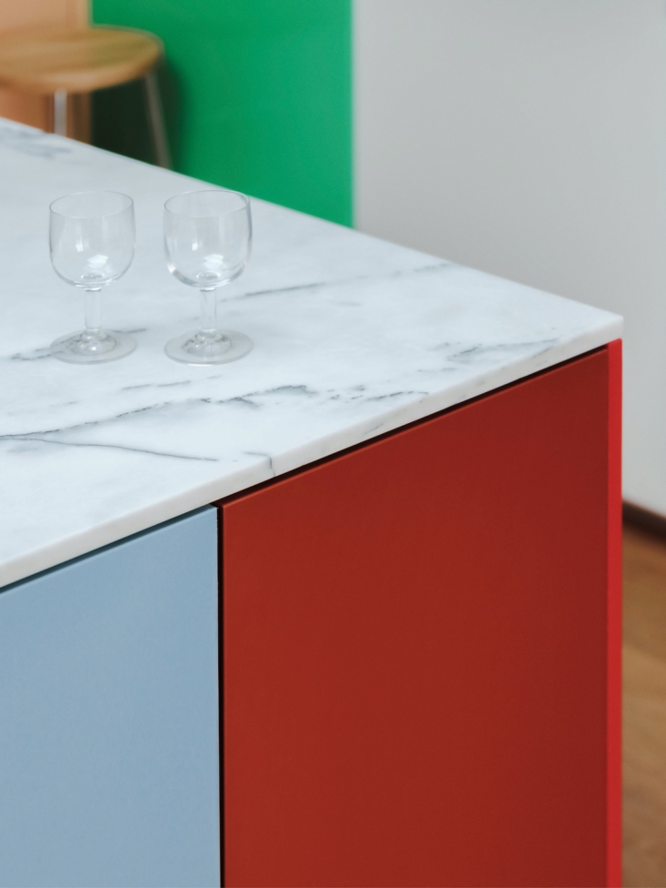 Marble countertops are a luxe counterpoint to the HDPE doors.