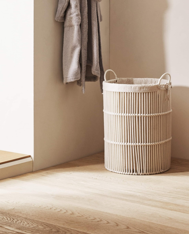 A good-looking hamper: The Round Fabric Lined Laundry Basket ($89.90) has a removable and washable cotton and linen lining.