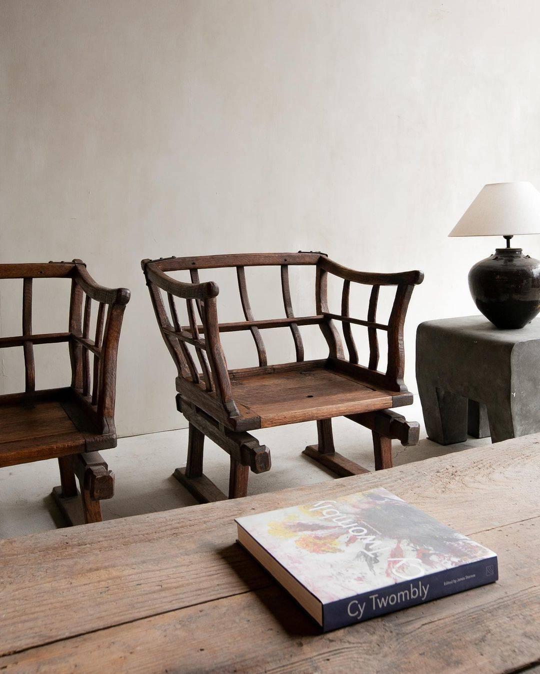 A pair of primitive wood chairs.