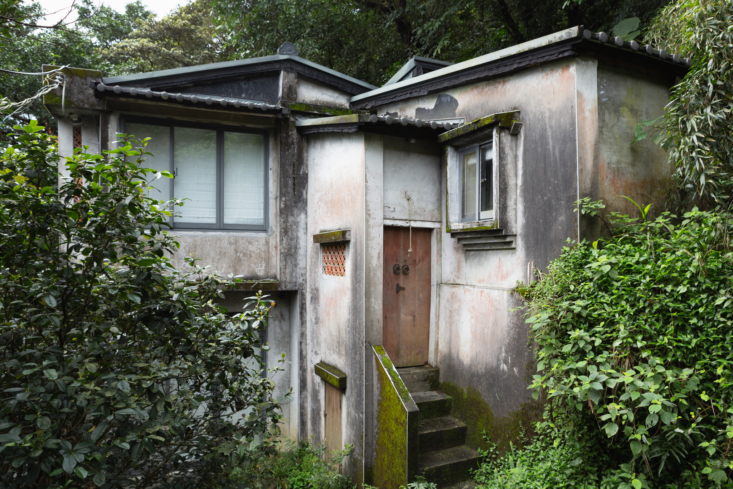 From the outside, Shu Shu House looks like the weathered concrete houses typical in the area.