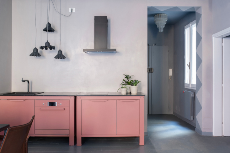 A Very Simple Kitchen in pink; note the genius powder-coated oven.
