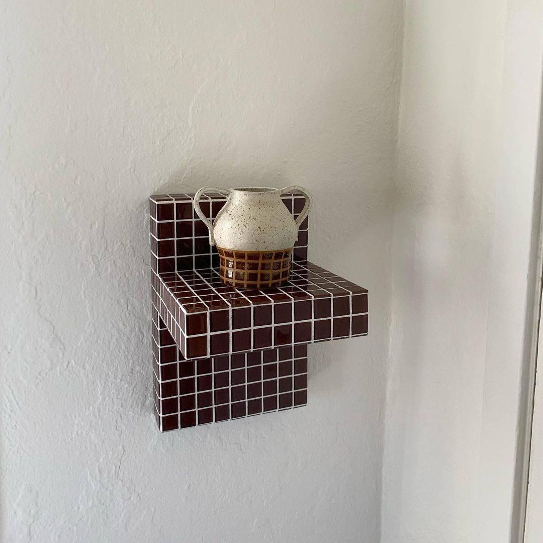 a floating shelf, \$\2\20, in a tile color called mushroom; handle vase by kels 18