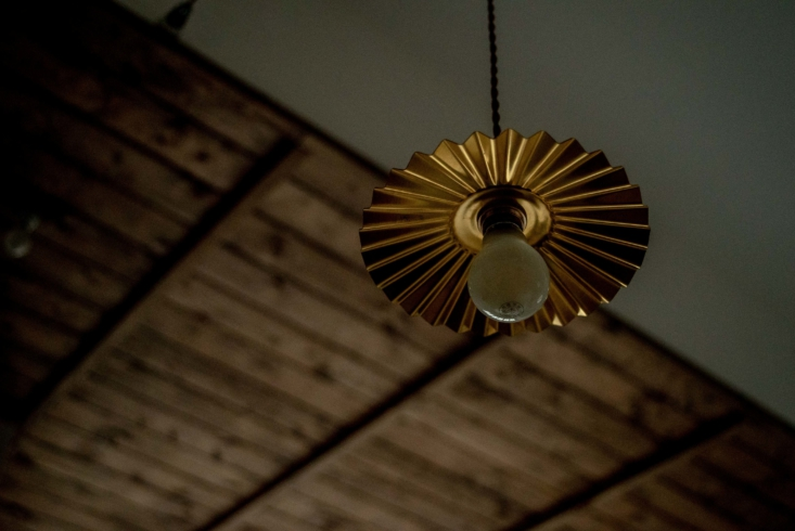 A pleated brass hanging light, $