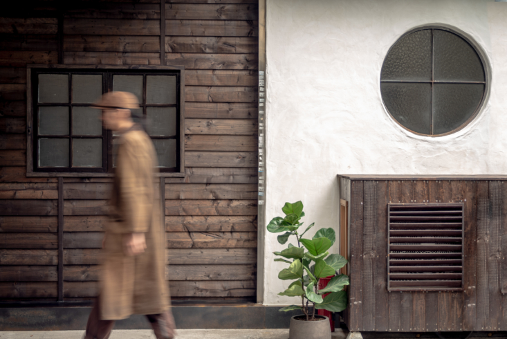 Reclaimed pine paneling was artfully applied to the side of the building. Find the teahouse&#8