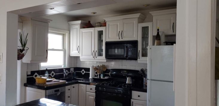 The original kitchen had a dizzying amount of cabinets hung all over the kitchen.
