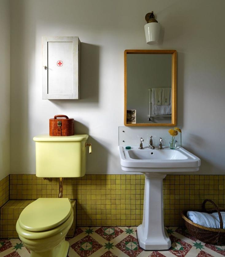 beata heuman bath with yellow fixtures