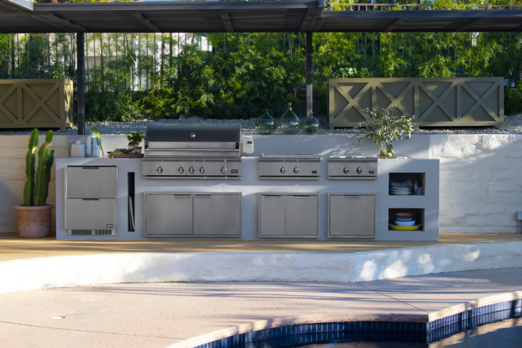 The suite of individual outdoor appliances is laid out linearly in this poolside kitchen, part of Chef Lefebvre's vision for ease of movement from fridge to grill to griddle to burner.