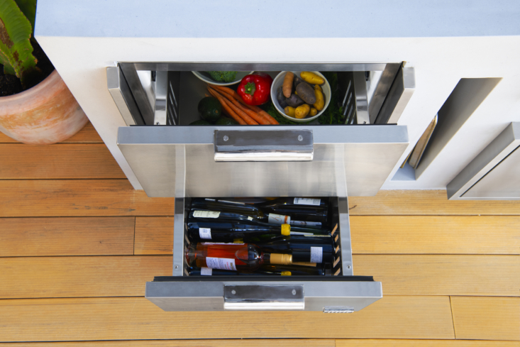 Keep your mise en place in the top drawer, chef style, with bowls of ingredients at the ready. The bottom drawer can act as a wine storage drawer to keep bottles cold for outdoor gatherings.