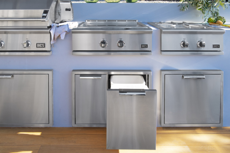 Just like indoor kitchens, outdoor cook spaces need good storage, too. Kit out your space with DCS' storage collection of stainless steel drawers, cabinets, mini pantries, even a Trash Bin, shown here, with two full-size removable bins that's sealed for protection from weather and pests.