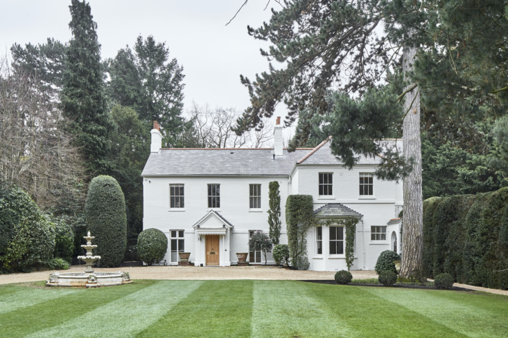 """The house rests on seven acres of manicured grounds and woodland. The 0-year-old yew hedge, at right, was restored with love and care that required clearing  tons of pine needles from the """"body"""" of the tree. Topiarist James Crebbin Bailey has looked after the trees there for years now."""