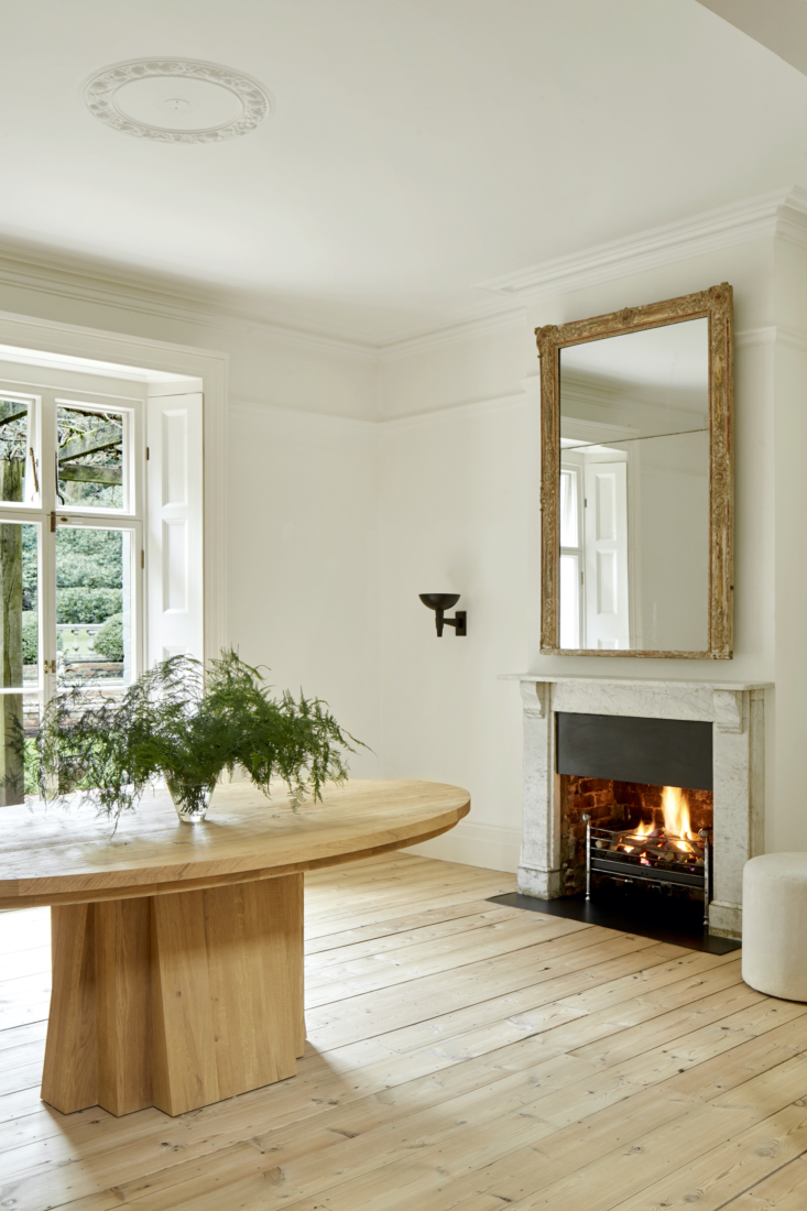 The oak Oval Table is another Rose Uniacke piece.