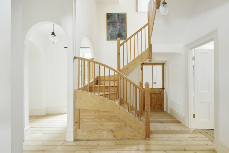 The house has a mix of the original pine floor and newly laid floor, all untreated and in keeping with the original. The staircase was stripped of layers and layers of shiny gloss, by hand, over the course of two months, by a single craftsman.
