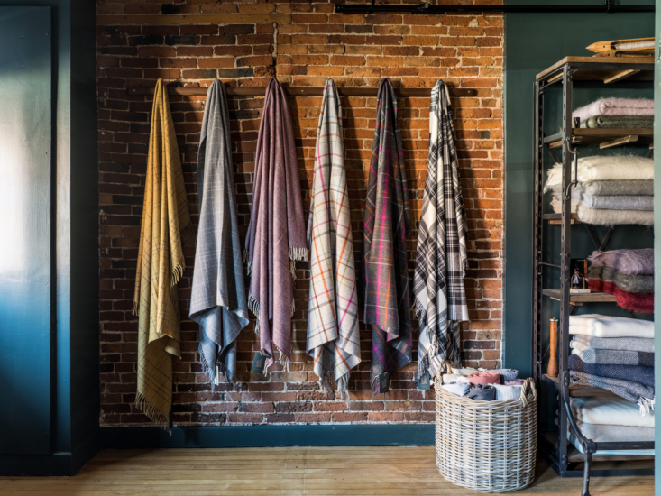 An array of Patterned Merino Throws against exposed brick. (Take a look at more throws on offer here.)
