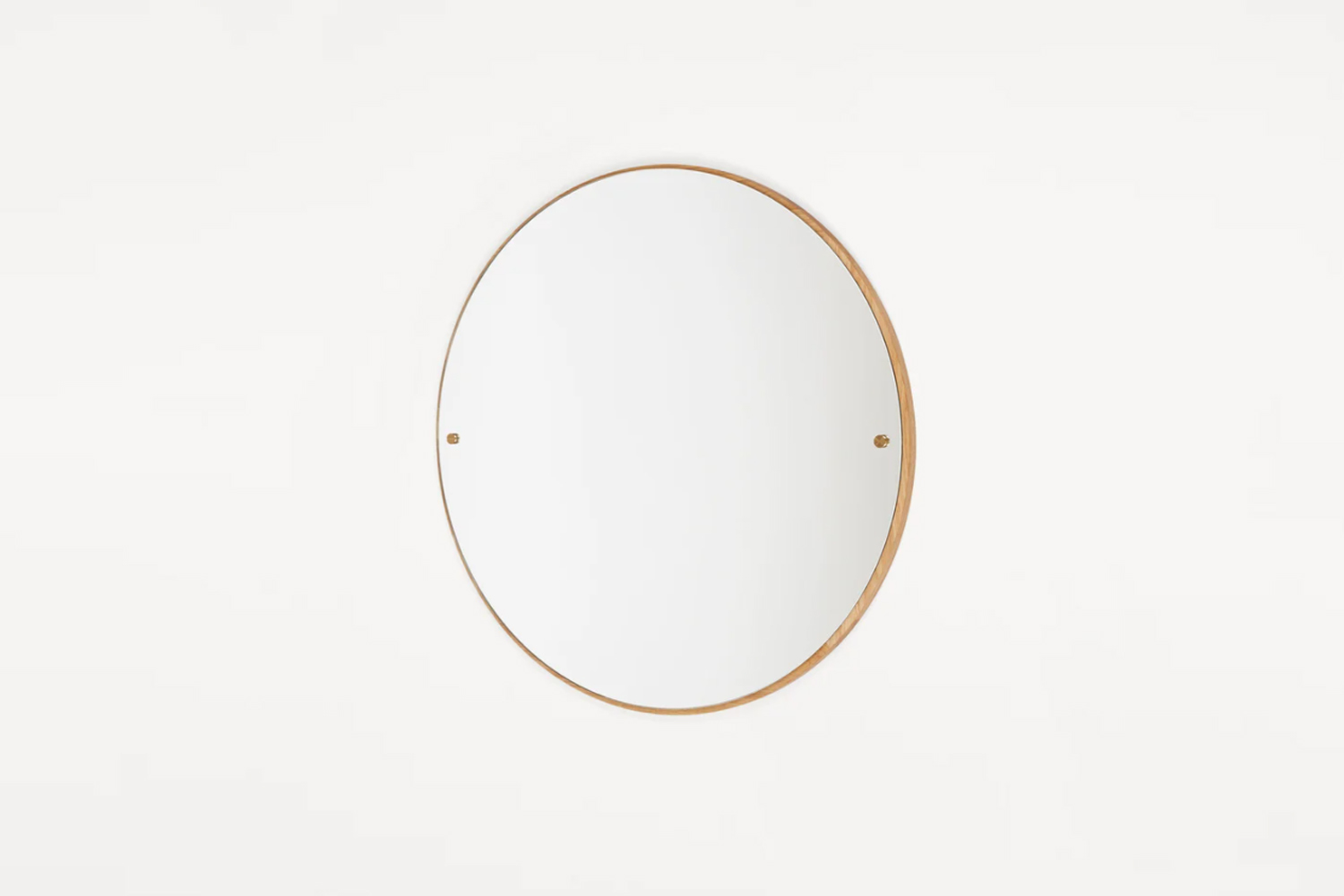 10 Easy Pieces Simple Round Mirrors The Frama CM \1 Circle Mirror is designed with an oak rim and brass screws; €385 at Frama.