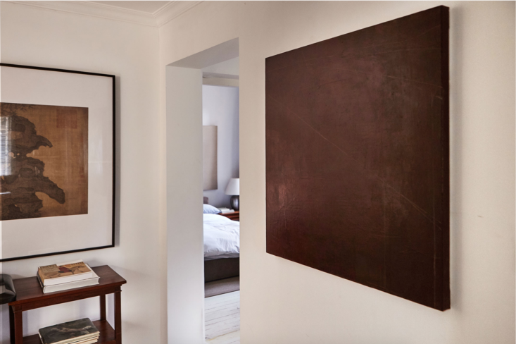 The passageway to the bedroom. The monochrome canvas and acrylic work is another piece from Studio Glume.