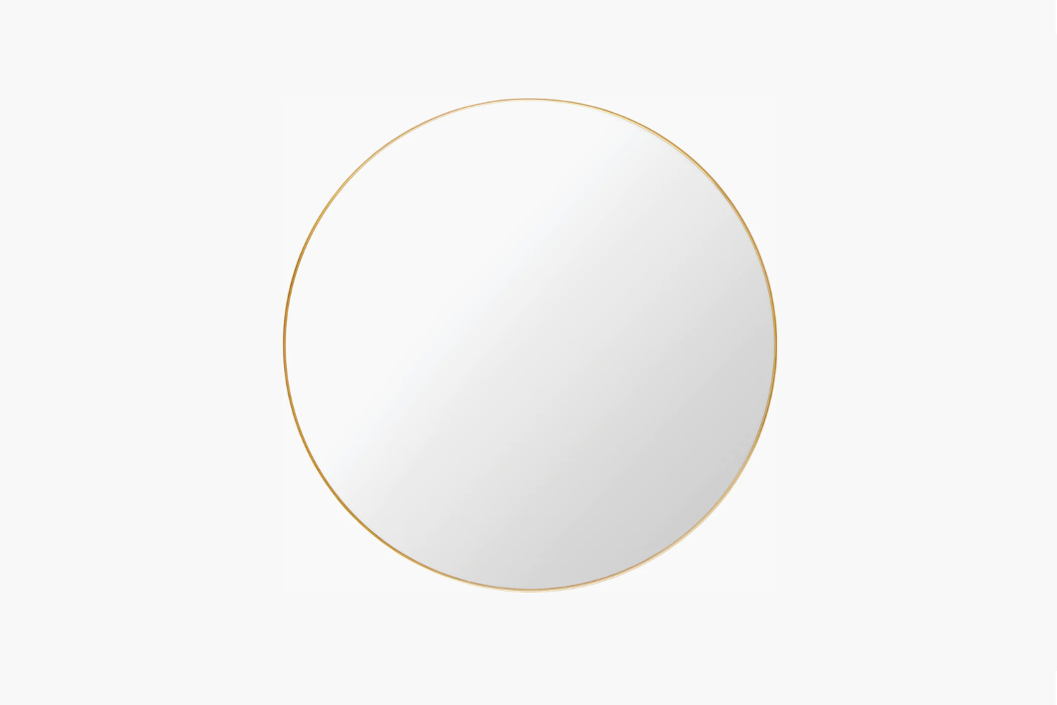 The Gubi Wall Mirror in Polished Brass is $loading=