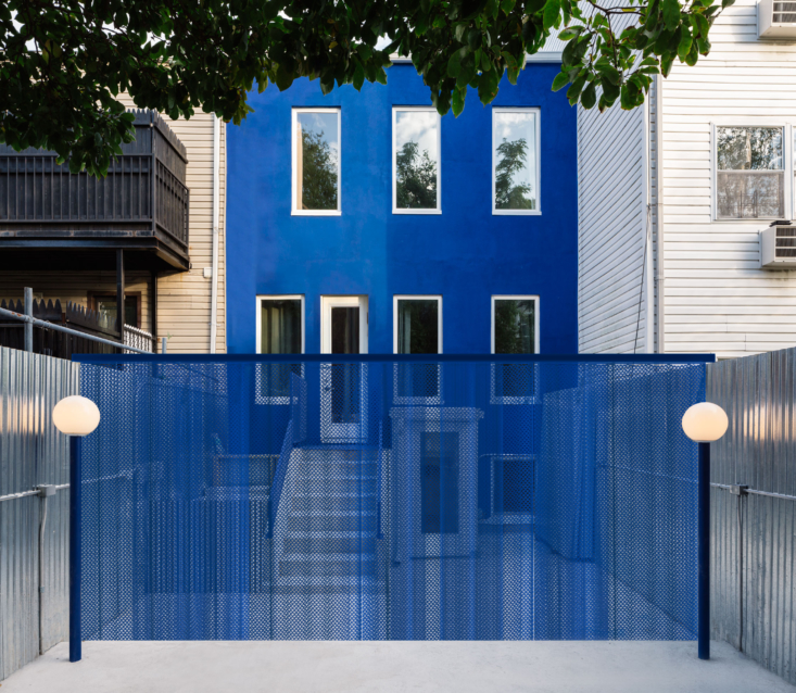 Another element of blue: a perforated aluminum curtain that can divide the outdoor space and add extra privacy for the first floor.