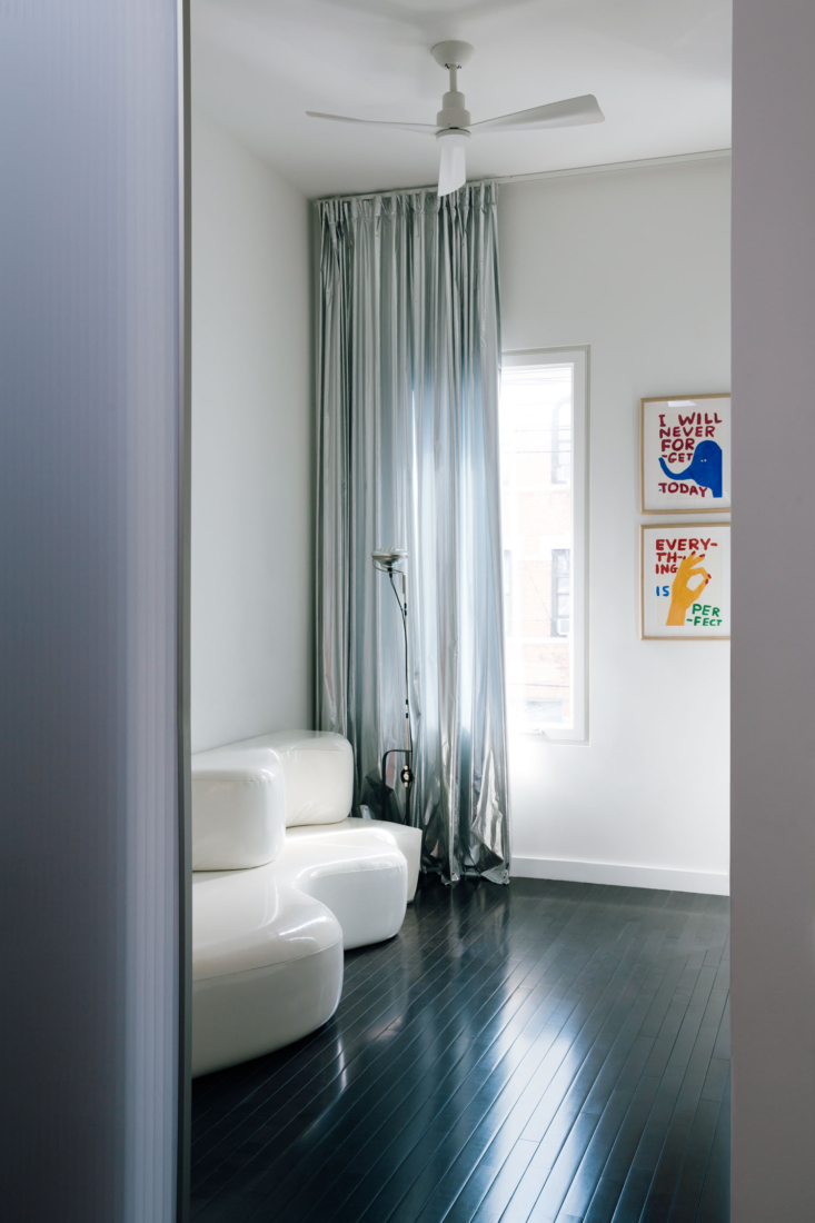 Mercury-silver curtains add a surprising backdrop to a sitting area (and emphasize the loading=