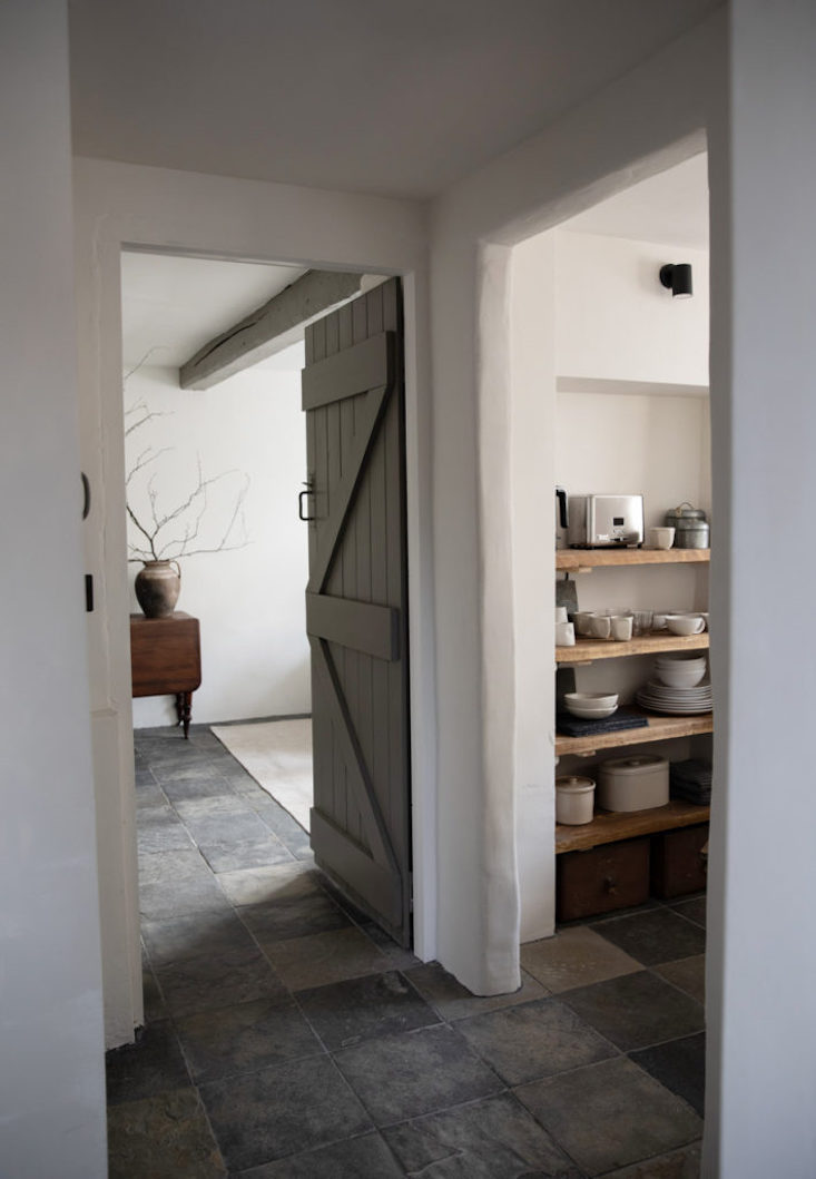 The slate-paved passageway to the main living area.