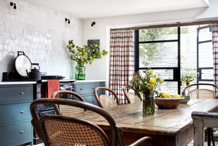 A farmhouse table extends across the kitchen, which the previous owners enlarged and opened to the back garden.