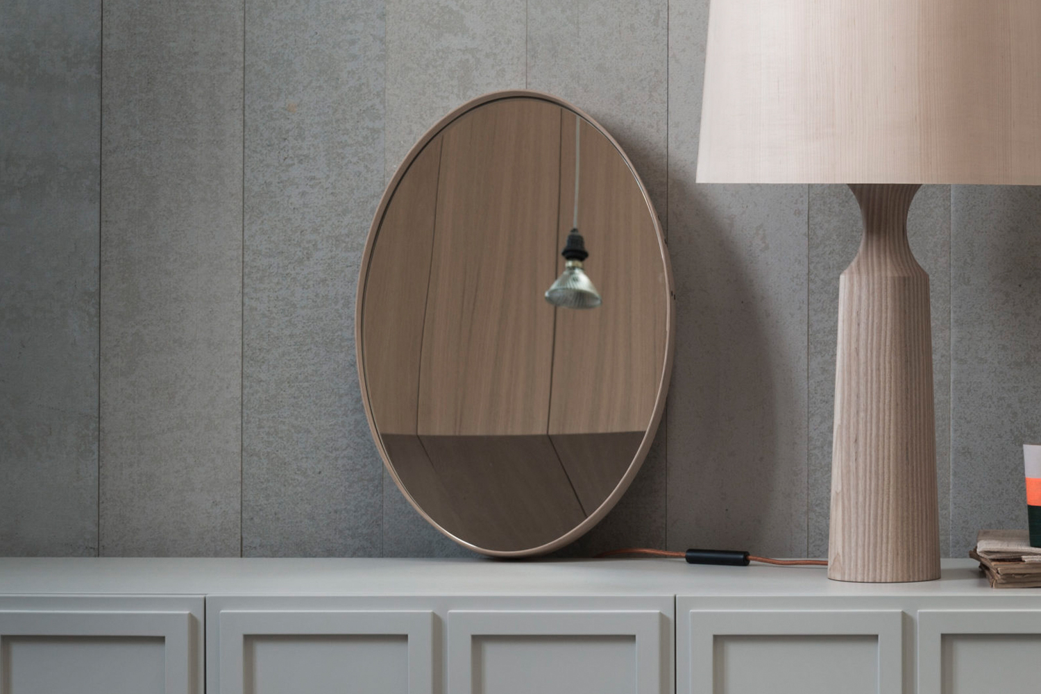 The Pinch Iona Wall Mirror comes in oak or walnut; $loading=