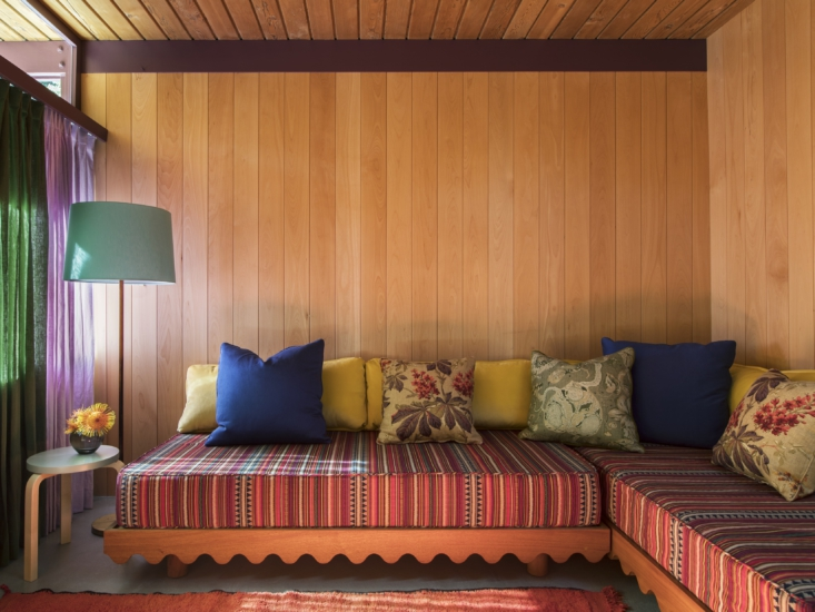 scalloped trim on a banquette in a paneled pool house in la by frances merrill  9