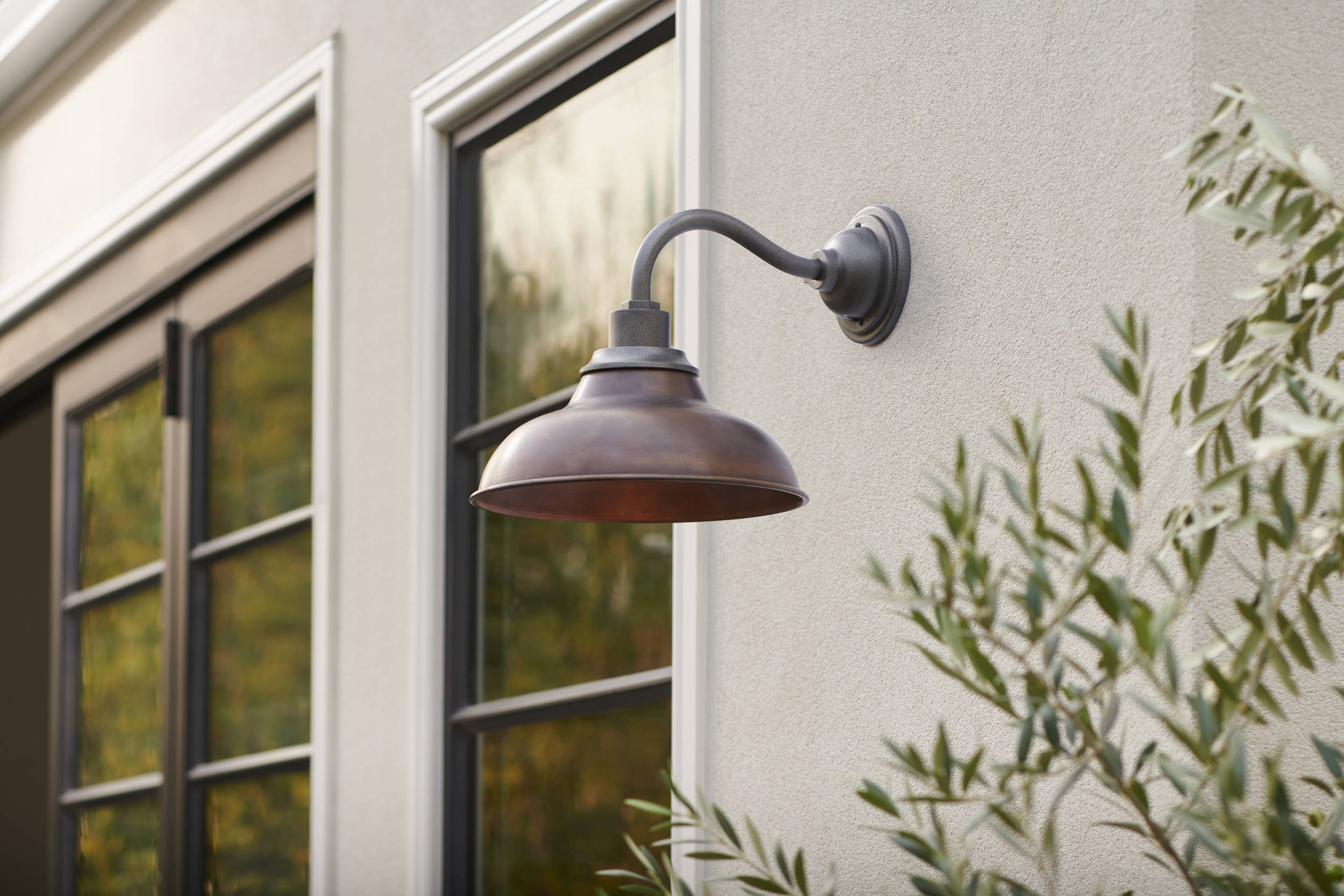 Any great outdoor space starts with the right lighting. From sconces, flush mounts, and pendants to path lights and portable options, Rejuvenation's collection of outdoor lighting increases visibility around your home. Shown here, the Carson src=