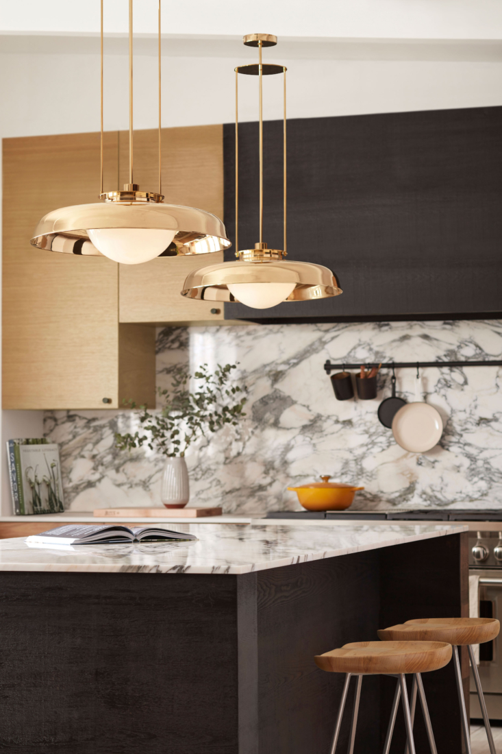 Consider the size and scale of your kitchen to determine whether one statement fixture is best—or two or three.