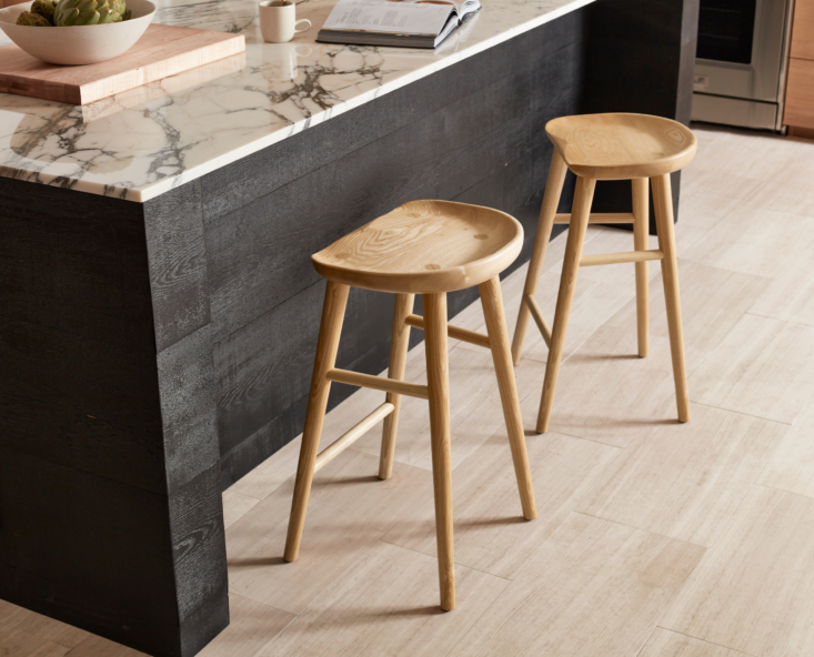In addition to being the workhorse of the home, the kitchen is also a gathering place for entertaining, remote-working, doing homework, and casual weeknight dinners. Don't forget to add comfortable and flexible seating to suit every need, like these midcentury-inspired Randle Tractor Counter Stools in solid natural ash with contoured wood seats (from $469 each). They're also available in walnut or black ash and with a metal base.
