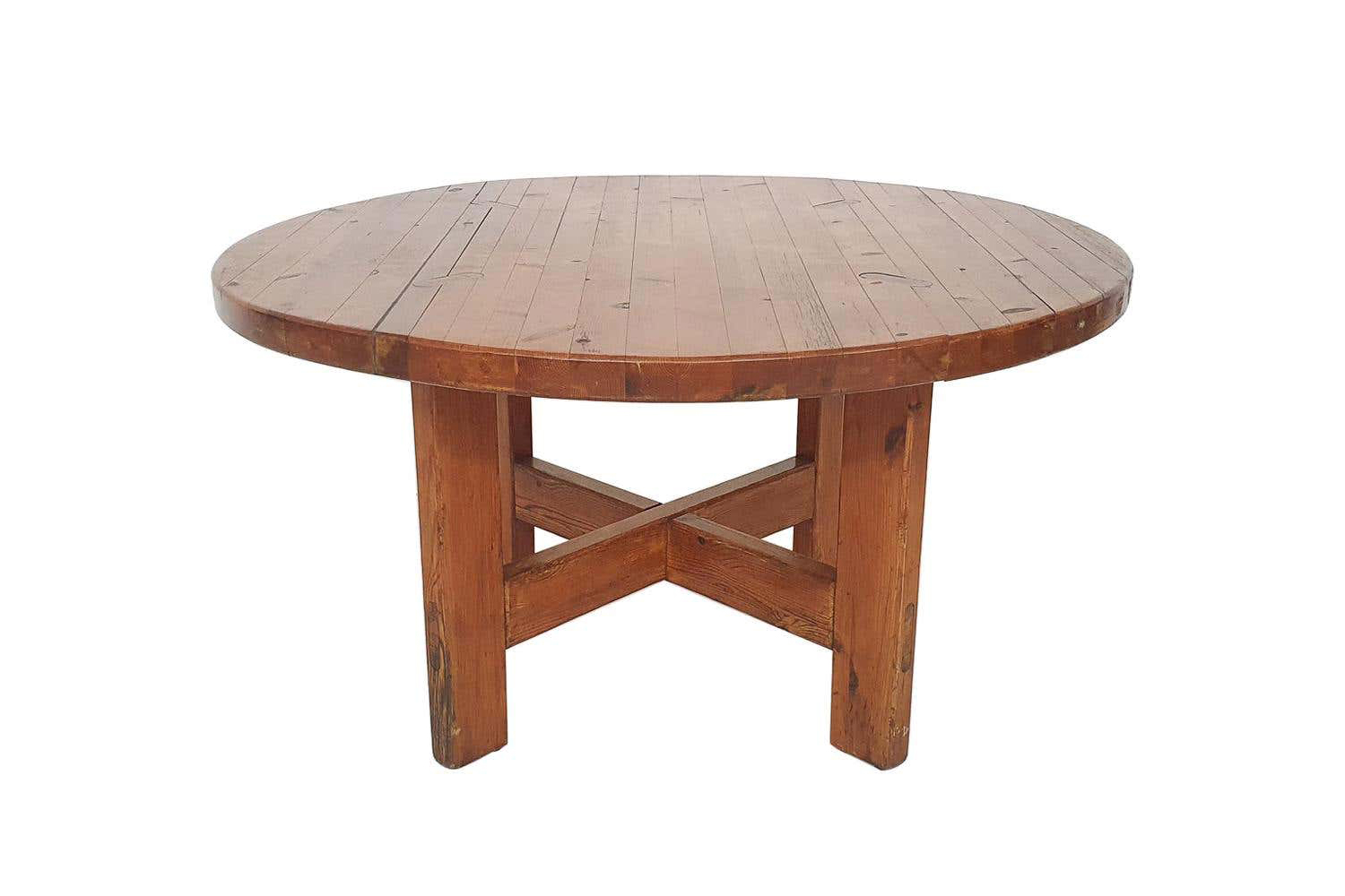 The family sourced a Roland Wilhelmsson for Karl Andersson and Soner Pine Dining Table at an auction. You can find it at loading=