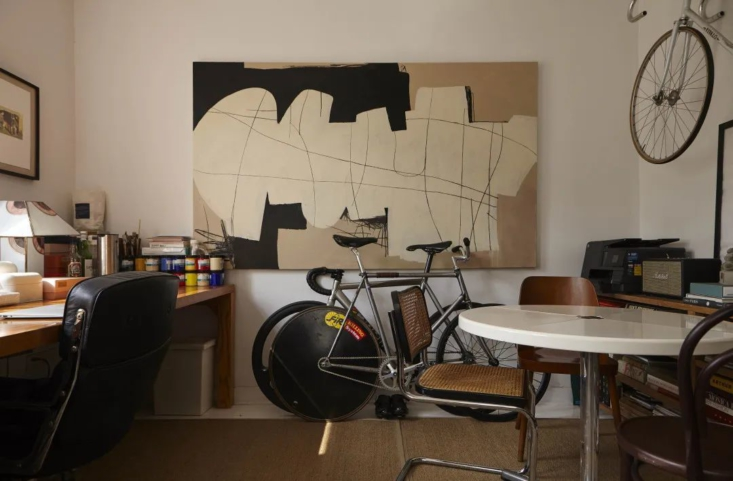 In the study, the hanging canvas and acrylic work is from Studio Glume.
