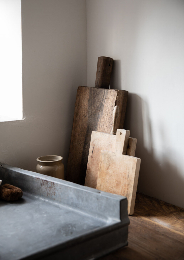Rough hewn cutting boards add to the rustic feel.