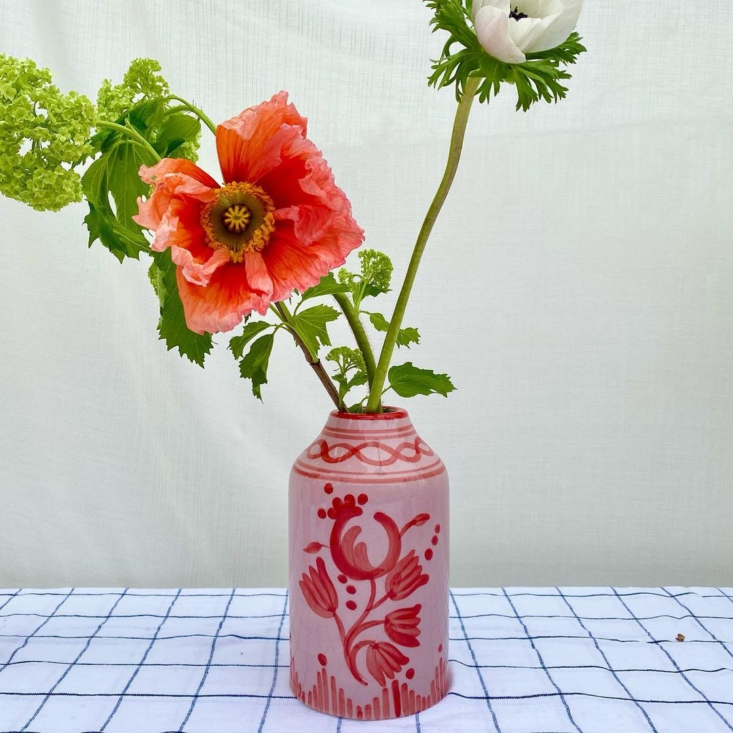 A favorite is the Genie in a Bottle Vase, shown in tone-on-tone Lilac and Red Floral and also available in Nude and Forest Green Floral, each painted with a th-century floral motif, each £75.