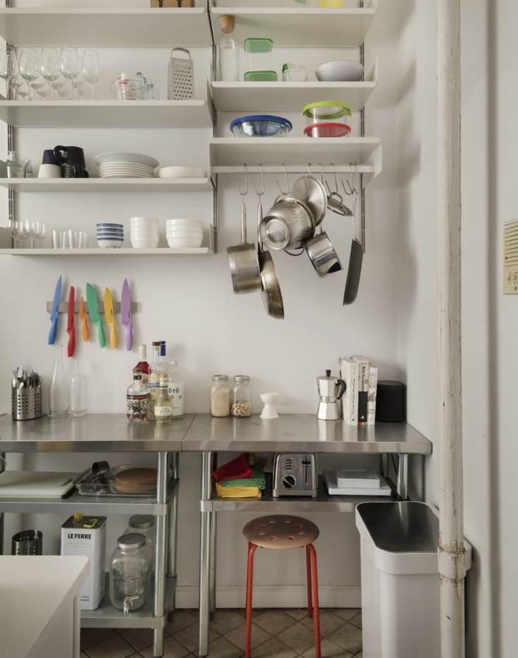The color story continues in the kitchen, which is put together with restaurant supply store stainless tables.