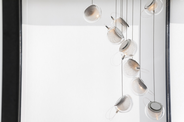 Another of Bocci's design-meets-technology offerings: the 76 Lighting System, with tendrils of white glass suspended within each of the glass pendants.