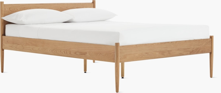 From Design Within Reach, the Cove Bed is available in oak (shown here) and walnut; the queen size bed is $loading=