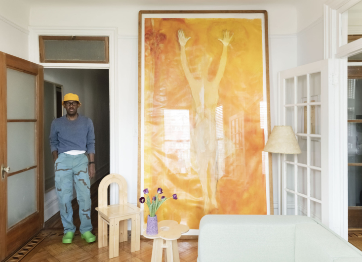 A painting by Ellen Frank anchors a wall in the living room.
