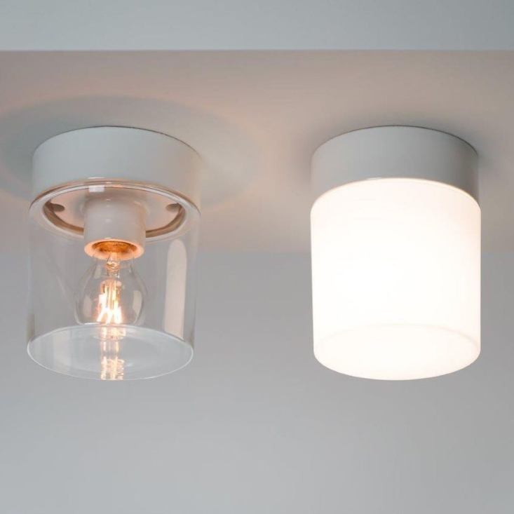 The Open Series is available with a white, gray, or black ceramic base and a clear or frosted shade.