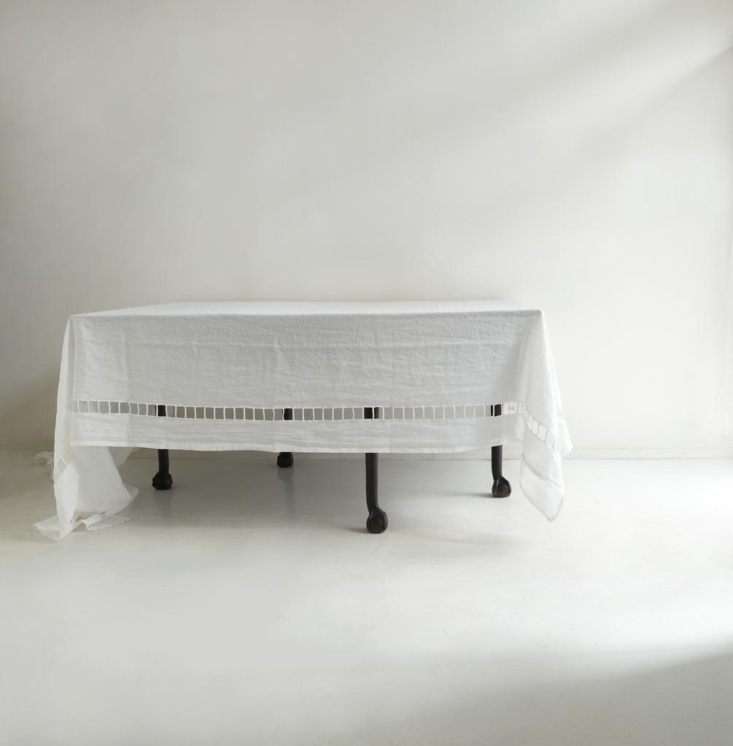 The Large Italian White Windowpane Tablecloth, which measures  by 7loading=