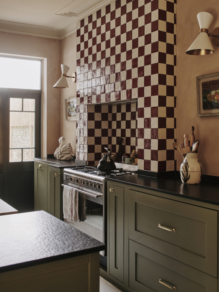 Her kitchen has become Instagram-famous, thanks to the photogenic oxblood and cream checkerboard backsplash behind the stove.