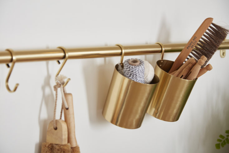 brass cups and hooks store all sorts of laundry must haves. 14