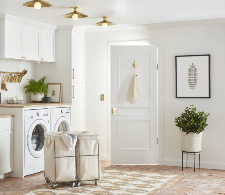 bins and baskets large and small are an easy way to keep the laundry room looki 12