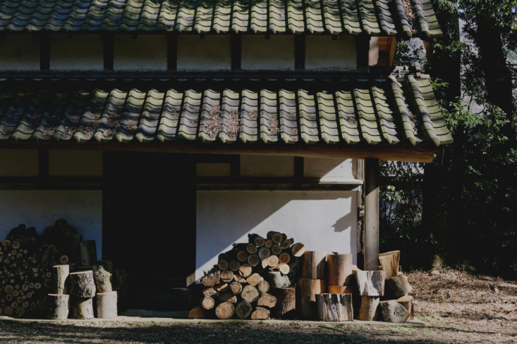 The outbuilding is used for firewood storage.