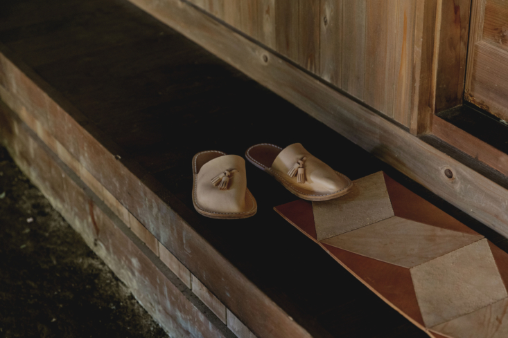 Leather slippers and rug by Hender Scheme. &#8