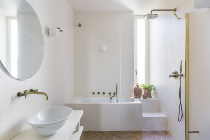 The main bathroom in palette-cleansing neutral tones. A sculptural bath and open shower space adds to the sense of escape and relaxation, even at home.