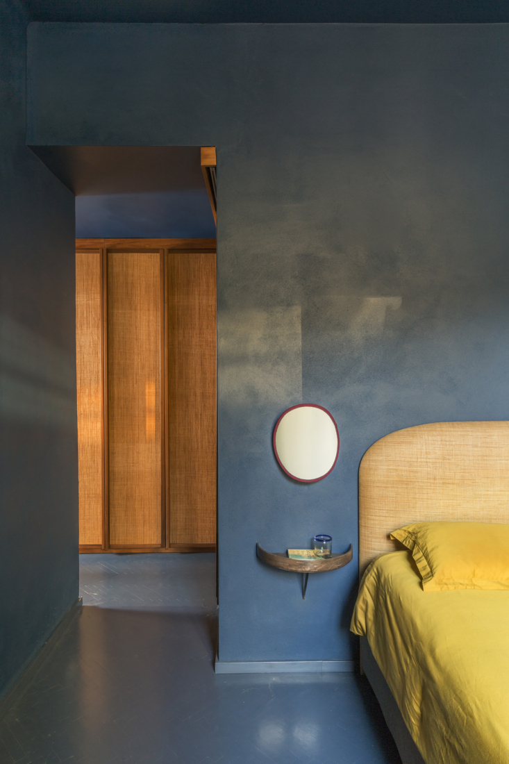 The main bedroom, all in blue—a nod to the Tivoli blue of the living area, now fully &#8