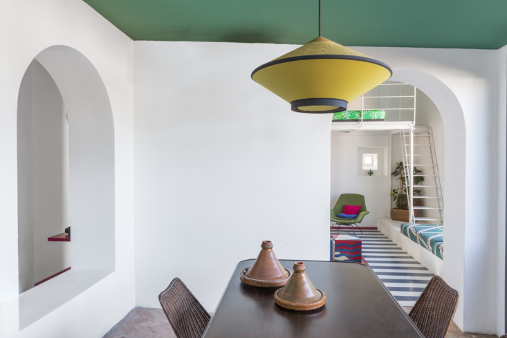 A swath of paint on the ceiling makes a surprising impact. The architects employed this hue (which they call &#8