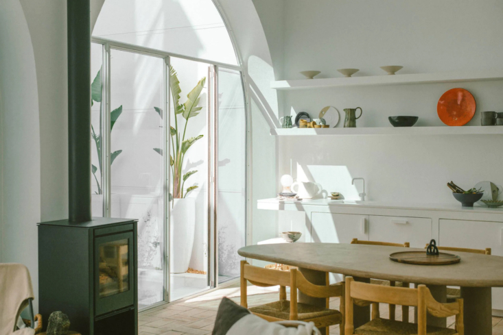 One Two Three Minimalist Guesthouses on the Coast of Portugal Pools Included Original archways bring bright light into the living area and the all white kitchen.